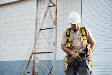 worker with climbing harness