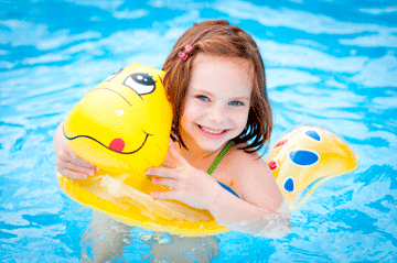 girl on inflatable in pool