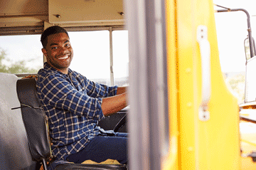 smiling bus driver