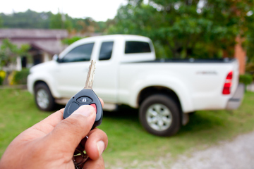 remote key pointing at a truck to unlock it