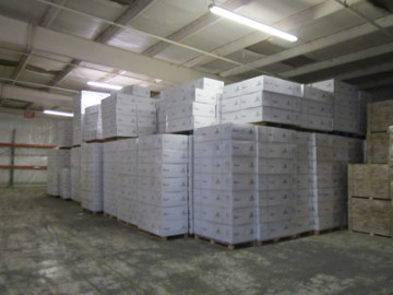 stacks of boxes near the ceiling and in danger of being destroyed if the roof sprinklers go off