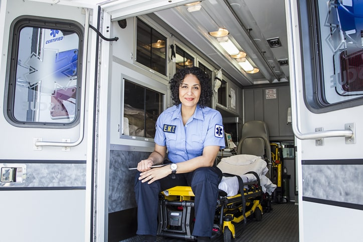 Female EMS worker in the back of an ambulance